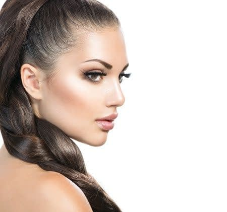 woman with long braid and eyelash extensions