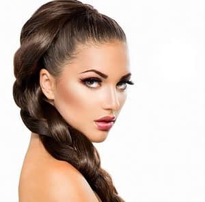 model with braided hair and eyelash extensions
